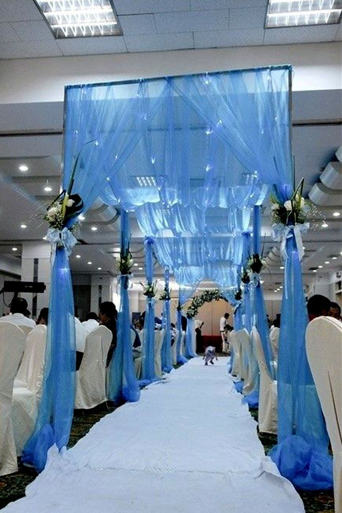 Bring the water inside with this beautiful waved, sheer satin drapery. A perfect way to have your nautically inspired wedding, even when your miles away from the water.