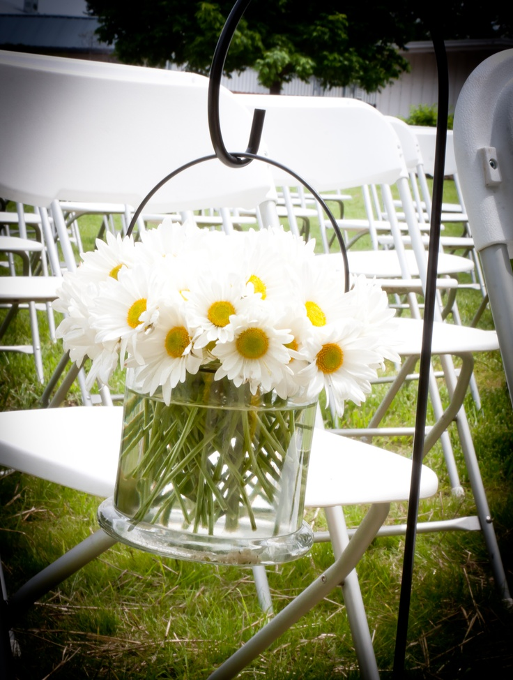 """Daisy Wedding Decor-by the front door of the Eagles with the sign """"Crunk and Owen"""" Wedding."""