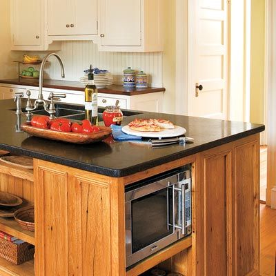 Add-Ons: Appliance Cubbies  Control clutter by stowing small appliances. Microwaves need at least 1 inch of clearance on all sides for airflow. Cubbies with finished interiors add about 20 percent to a cabinet's cost.     Similar to shown: Custom cabinet in hickory; Plain & Fancy