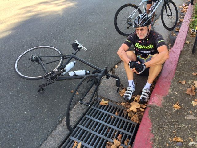 """This ever happen to you? Avoid rolling over sewer grates, even """"bicycle friendly"""" ones. (Sorry about the broken thumb, Eric. Get well!) #cycling #wheel #sewergrate #wheelmuncher"""