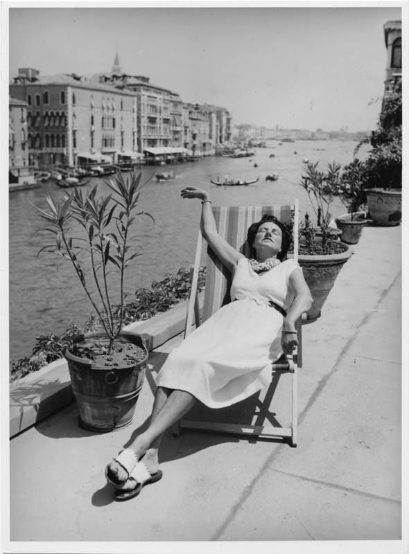 Peggy Guggenheim by the side of the Canal Grande in Venice. Part of her art collection is still there.