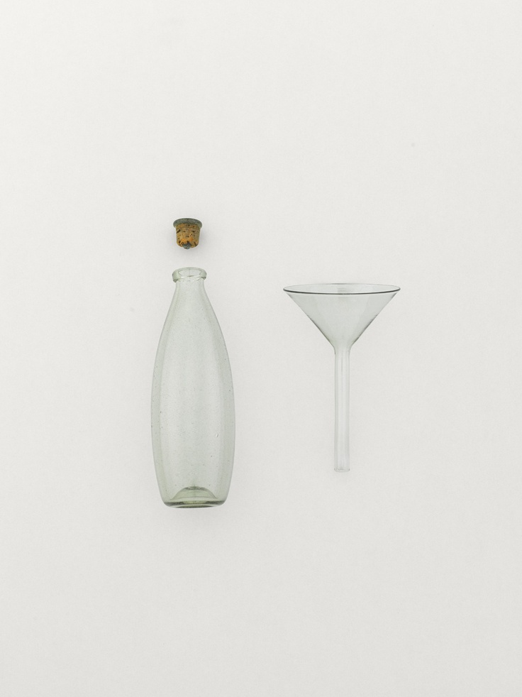 glass bottle & funnel. by arts & science.