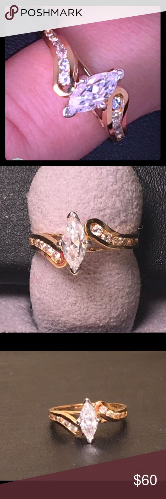 Cubic Zirconium GoldPlated Ring Gorgeous in person Flexible on price. Standard Ring Size. This is what is called a demo ring. My family used to be in the jewelry business. So to be clear and up front this is not entirely real. I have worn the same one for over 2 years almost daily and it is still in immaculate condition. It is brass, but gold plated. It is also cubic zirconium. Amazing fashion ring or temporary engagement ring until you can get a real one. Please let me know if you have any…