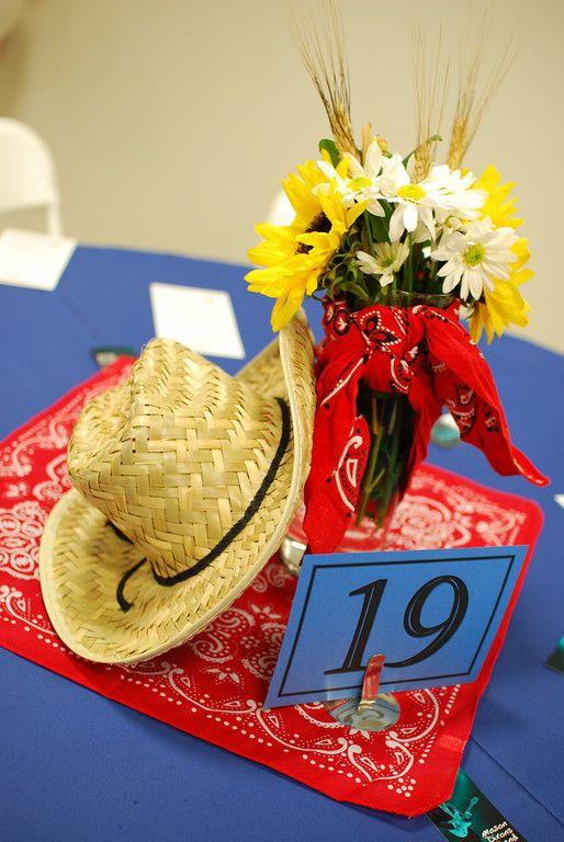 #Western centerpiece | #cowboyhat #flowers #sunflowers #themeparty #daisy