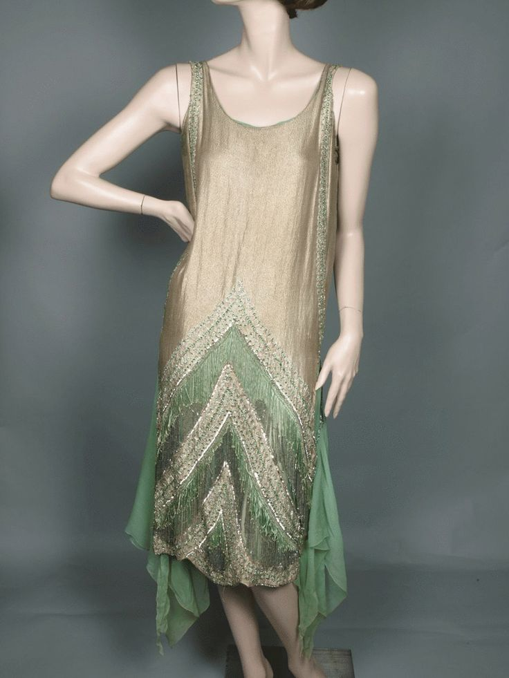 1920's Beaded Flapper Dress. Fashioned from light green silk chiffon and a glorious gold lame , light golden high lustre silk with 'flecks' of gold metal on the reverse. Hand tailored, partially hand beaded. Gold stitching, the finest craft, exquisite fabrics.  The beading consists of silver plaitlettes, silver seed beads, silver bugle beads and stunning green rose montees. Green silk and bugle bead fringe, a stunning scalloped motif terminating at the scalloped hem.