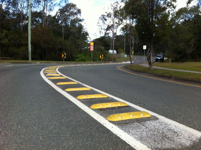 Installed by Logan City Council these Yellow 600MM Rumble Bars, or Pavement Bars warn drivers of an upcoming sharp bend and keeps vehicles to their side of the road. Supplied by Speed Humps Australia with all bolts and washers these Rumble Bars can be either bolted or glued to virtually any surface. Installation can also be arranged by our qualified team of installers.