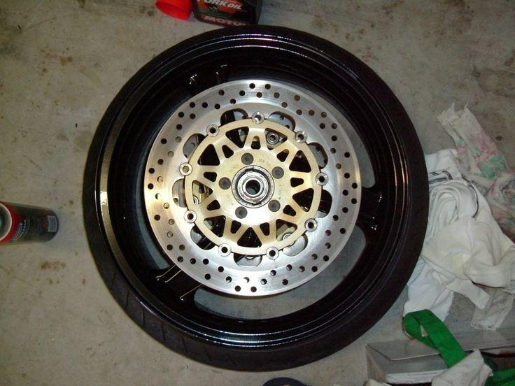 Reassemble of rotors on newly powder coated wheels.