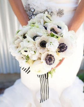 Anemone and ranunculus bouquet with ribbon