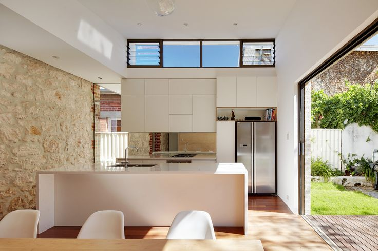 Like - the slider into wall, kitchen  Island and top windows