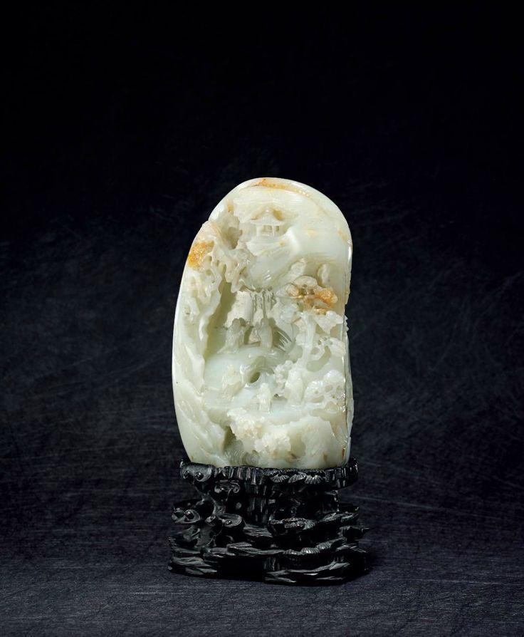 A superbly carved pale celadon jade boulder, Qianlong period (1736-1795)