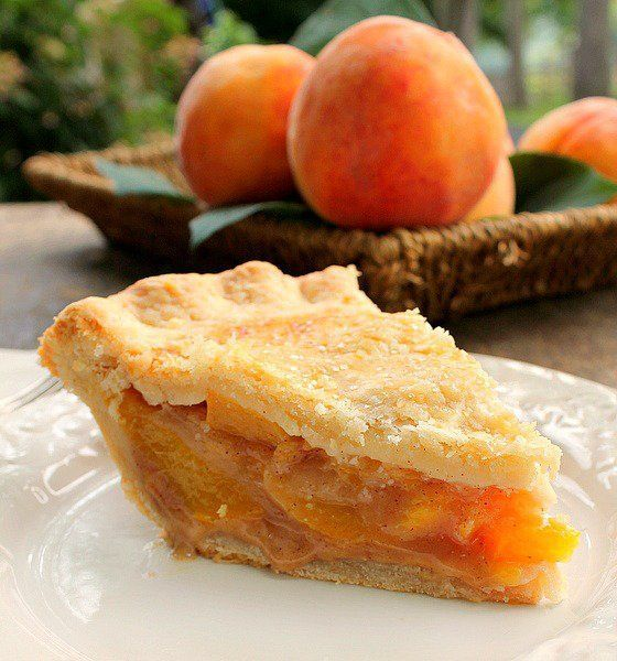 Flaky crust embraces the peaches.