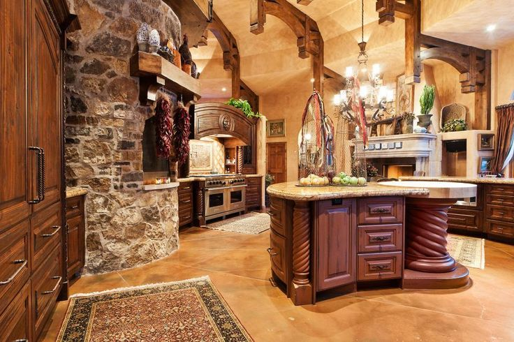 mediterranean kitchen with stone pizza oven and island