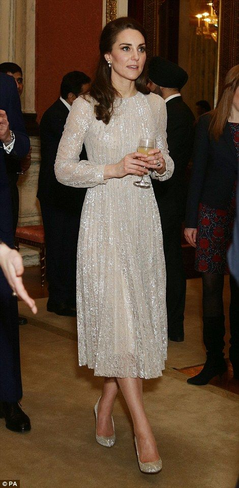 Lighting up the room: The Duchess of Cambridge paired her stunning Erdem dress with £590 Oscar de la Renta pumps