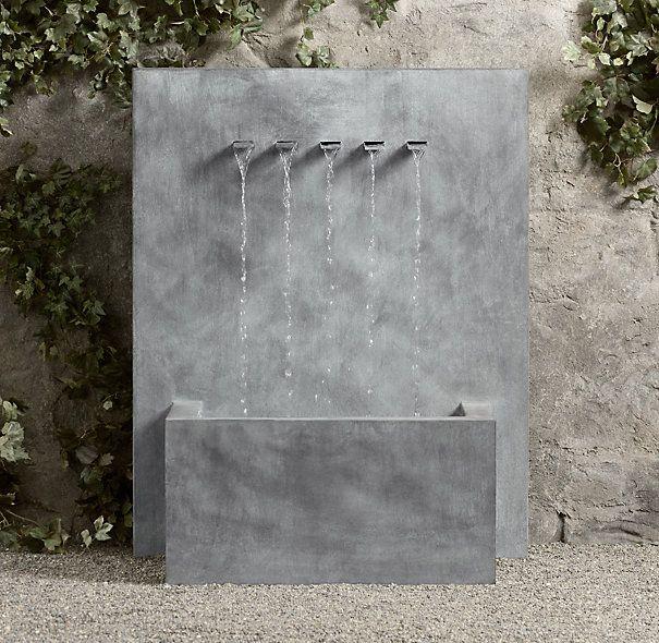 Weathered zinc wall fountain