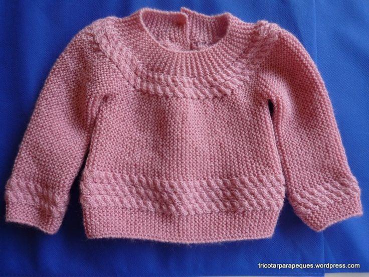 Otra versión del jersey para bebé publicado en este blog, modelo 4. Esta vez en color rosa, con una cenefa de ochos en el cuello y bajos.  El modelo se realiza empezando por detrás, en la tap…