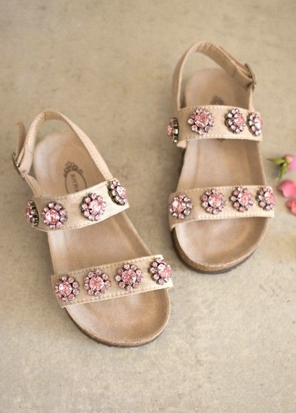 These comfortable blush strapped sandals are adorned with sparkly embellishments that can dress up an outfit or be versatile enough to be worn to the pool or beach. Comes with a matching clip!
