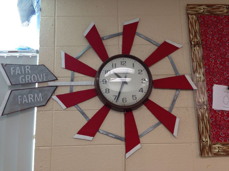 Farm theme windmill around clock for classroom or school nurse. Made from cardboard, paint and duck tape.