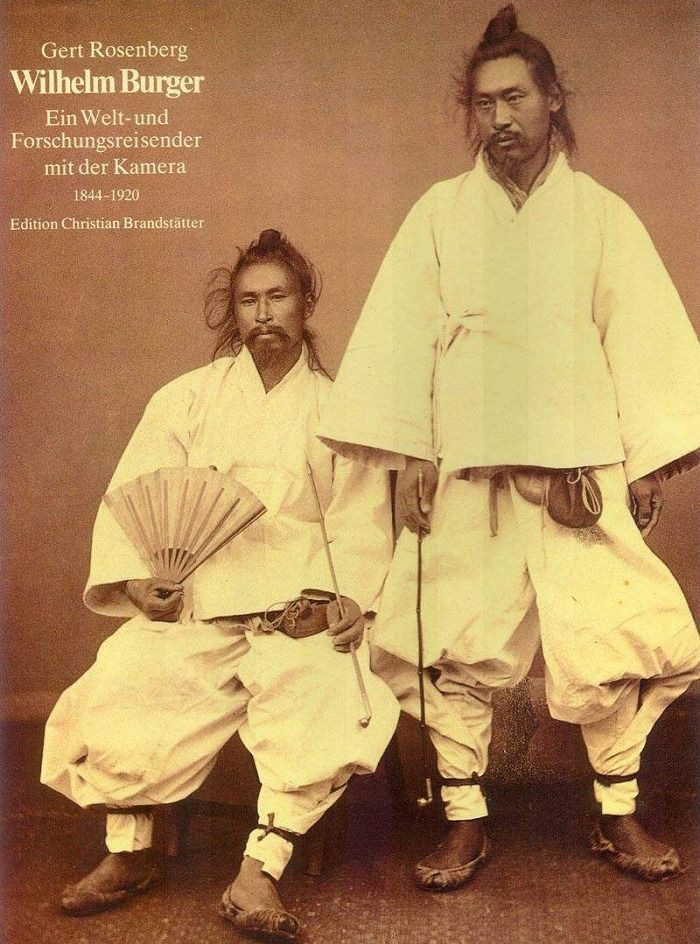 Korean men in traditional clothing taken sometime in the early 1900's
