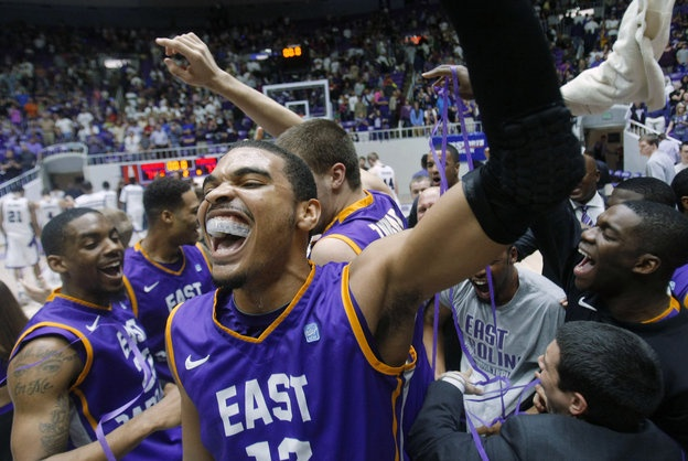 East Carolina's Robert Sampson joins his teammates in celebration after they defeated Weber State in the CIT championship college basketball game Tuesday, April 2, 2013, in Ogden, Utah. East Carolina won 77-74. (AP Photo/Deseret News, Scott G Winterton)