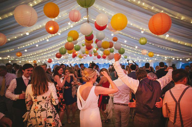 Bride & Groom First Dance - Helen Lisk Photography   Colourful Hanging Paper Lantern & Flower Filled Marquee Wedding   Bespoke Dresses & Tweed Suits