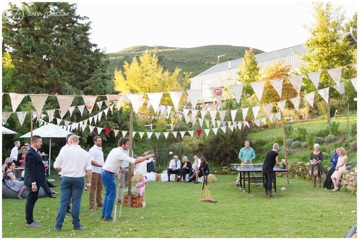 Pre-drinks reception area outside on the lawn. Wedding games entertaining the guests. Boulle, croquet, table tennis. Self made bunting decoding the area. #ZaraZoo