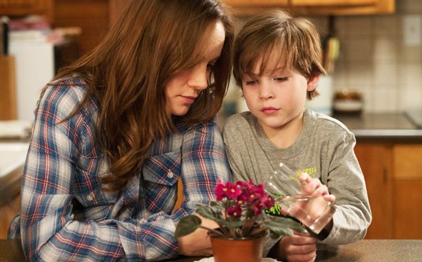 There are actually two stories in Room, director Lenny Abrahamson's adaptation of Emma Donoghue's best-selling novel about a young woman held captive for seven years in a small shed along with her 5-year-old son, Jack. He's never stepped a foot outside, never even seen a tree, and she's taught him from birth that the entire world ends with the four walls that surround him.