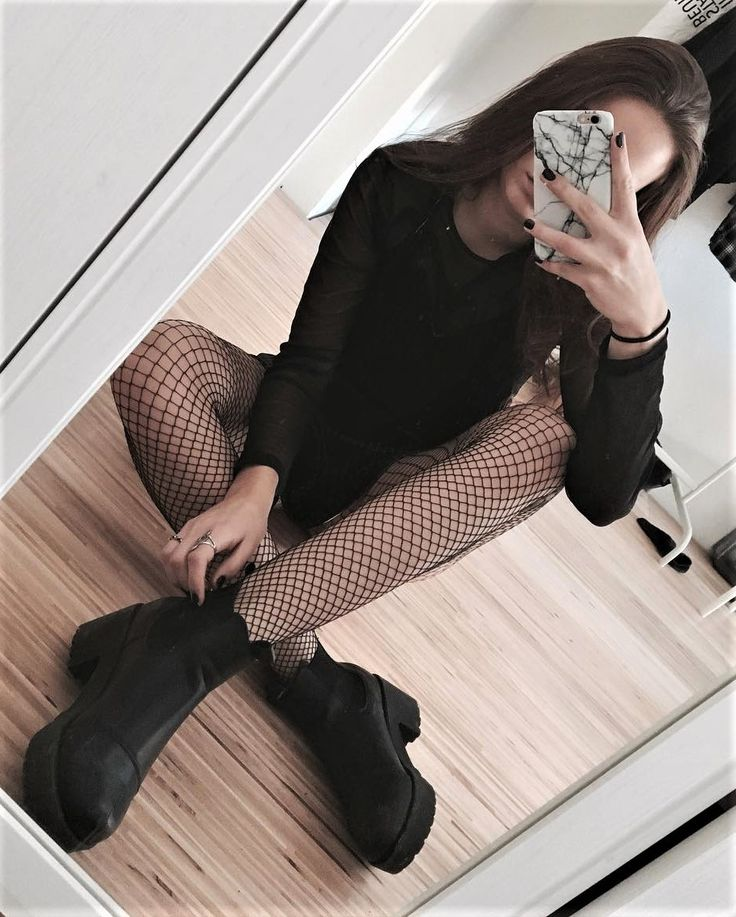 Black long sleeves shirt with fishnet tights & boots by strng.xo