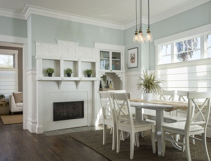 The home updates original built-ins--like this gas fireplace off the dining area. Photo: Scott Hargis Photography
