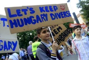 Boy attends a protest against Hungarian Prime Minister Viktor Orban's immigration policy proposals in central Budapest