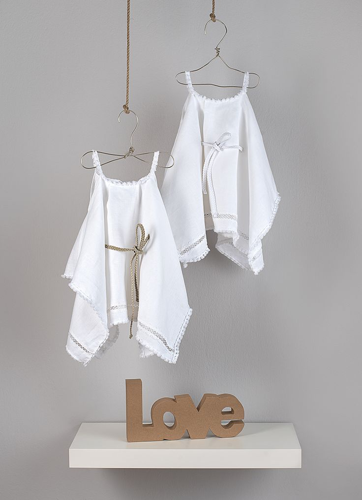 Ancient Greek style tunic in white linen with trims and plait belt in three colors (Gold, white and pink).