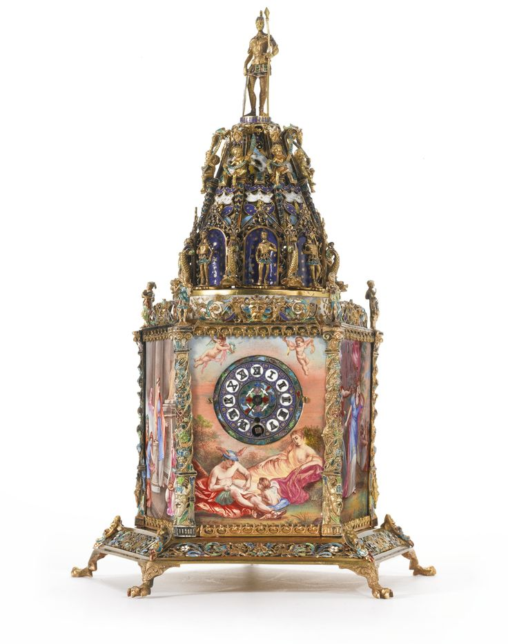 Austrian silver-gilt, enamel and gem-set five-sided tower clock, attributed to Hermann Boehm, Vienna, circa 1890, on five claw feet, strapwork borders centered by masks, the sides finely enameled with mythological scenes, the angles topped by figures, the spire with warriors before star-decorated niches, above putti alternating with emeralds below bearded masks, warrior and shield finial
