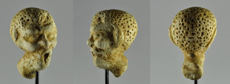 Greek grotesque head, 1st century B.C. Alexandria, 6 cm high. Private collection