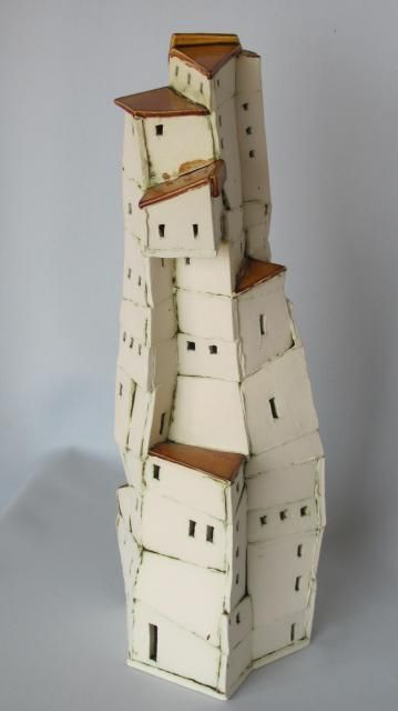 Crazy house by Carol Robinson. . More ref for tall spindly houses and houses on tall spindly hills.