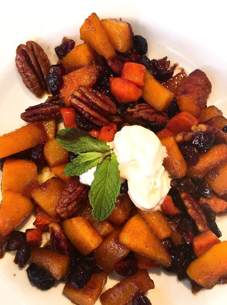 Dessert, caramelizad cinnamon pumpkin and carrots with nuts. Served with vanilla bean ice cream