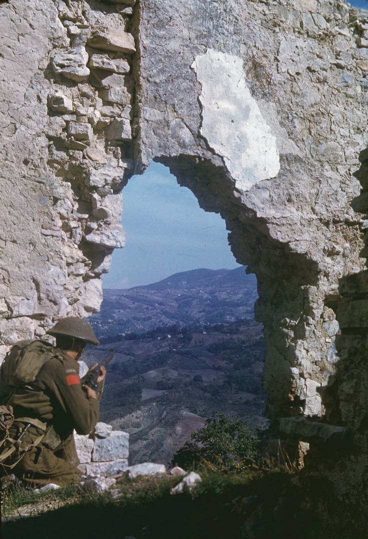 "26 October 1943 - On this day, 70 years ago, Canadian Film & Photo Unit photographer Lt. Terry Rowe was in the mountain village of Colle d'Anchise when he captured Private M.D. White of The Loyal Edmonton Regiment observing through a broken stone wall in the village. Rowe shot this photo with two different cameras — one for this colour transparency, and the other a B&W 2-1/4"" square format, perhaps a Rolleiflex as used by other WW2 photographers like Robert Capa and Ken Bell."