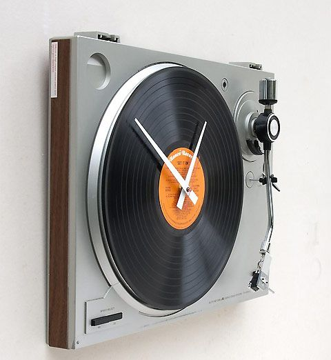Clock made from recycled turntable.