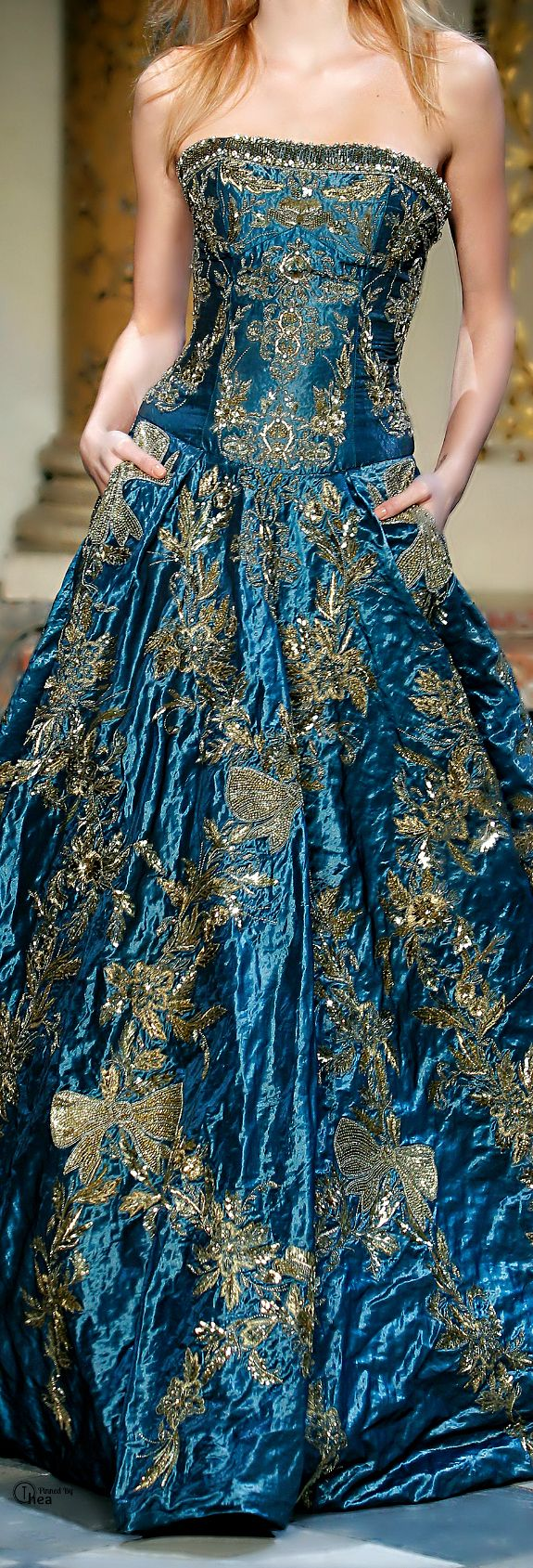 Zuhair Murad. [I don't like strapless or the embroideried bows, but the color with the gold is beautiful]