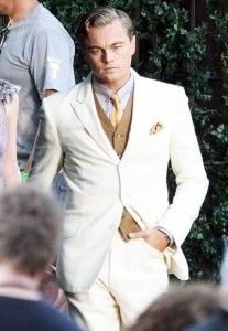 Great Gatsby white suit with gold vest, tie and pocket square is a great summer grooms look.