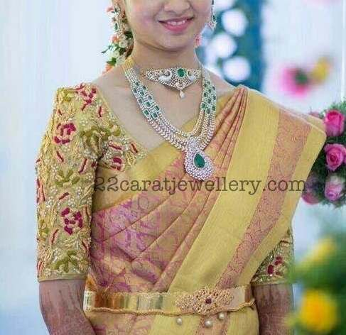 South Indian bride worn three rows diamond emerald classic and elegant look long chain with elaborated diamond emerald pendant in the cen...
