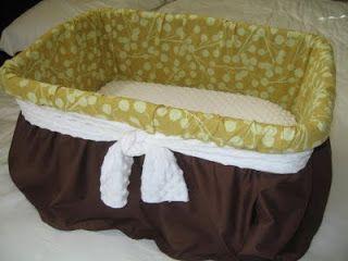 Laundry basket bassinet.  Add elastic under the bow... easy peasy!