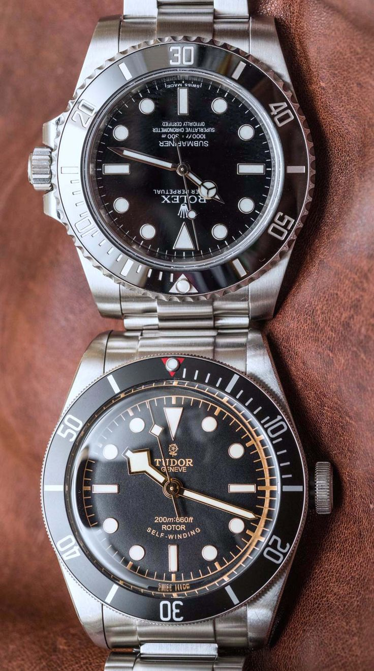 """Rolex Submariner 114060 'No Date' Vs. Tudor Heritage Black Bay Black Comparison Watch Review - by David Bredan - See the showdown at: aBlogtoWatch.com """"This is a big one, and something that took a long time to come together: today, we review and compare every single detail of the Rolex Submariner 114060 'No Date' and the Tudor Heritage Black Bay Black. It may sound weird today but it's true nonetheless that, a few years ago, Tudor could not have been as widely considered a viable…"""
