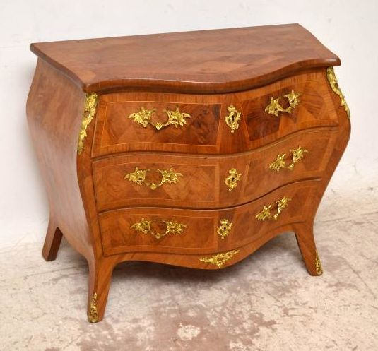 This antique Swedish bombe commode is unusual in that it has a polished top, because they usually come with marble tops. This commode is fantastic quality & has a great shape.This commode has fabulous quality gilt bronze handles, mounts, feet & escutcheons. There are locks in all the drawers which also have fine dovetails, but I don't think we have a key. I would date this piece to around the 1860-80 period.