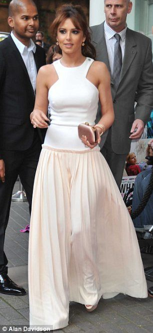 Cheryl cole in Victoria Beckham. I know the skirt bit is a bit off but there's something very fresh & summery about it