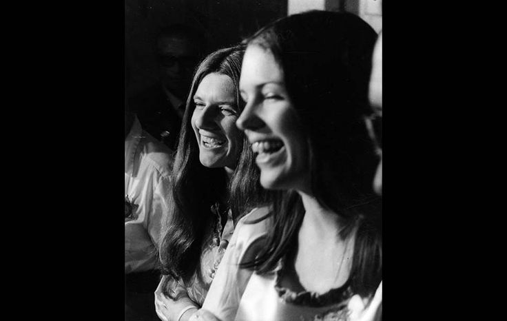 May 27, 1970: Charles Manson family members Patricia Krenwinkel, left, and Leslie Van Houten laugh as they are led into court for hearing.