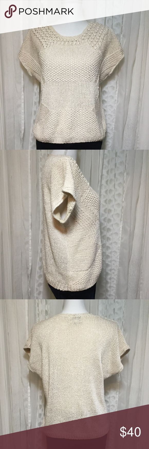 Vintage 80s Cream boxy chunky knit sweater This lovely hand knitted sweater is cream with a shine thread Mixed in. Tag reads hand knitted. No fabric or size tag. I would guess small or medium please see measurements Chest 21 inches Length 22 inches Definitely some type of cotton blend. Top part is slightly see-through. Sweater is very unique has different types of stitch as well as patterns. Very boxy style with no real defined shoulders. This is a classic and timeless piece, very on trend…