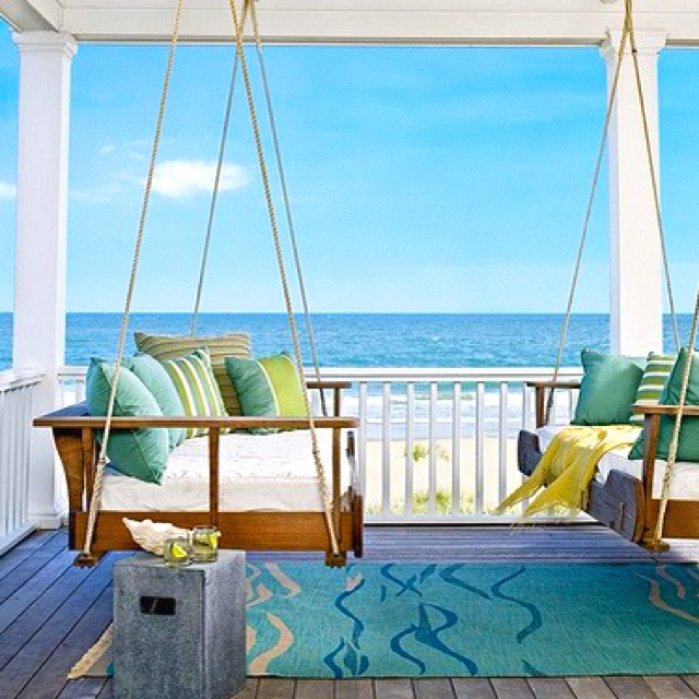 Wrap around porch AND sofa swing on the beach. In love.