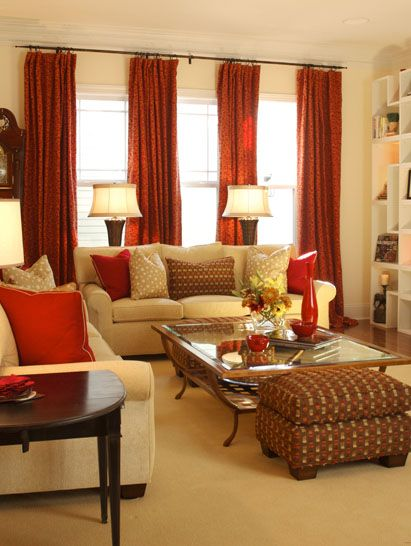 Gold and red living room with puzzle shelving ~ I like this...the couches are really nice