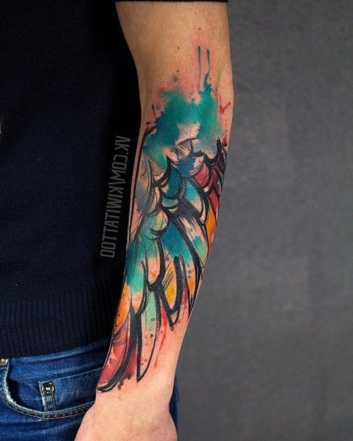 Watercolor Forearm Tattoo Angel Wings Tattoo On Back Man With Black Top Jeans Grey Background In 2020 Wings Tattoo Angel Wings Tattoo Bright Tattoos