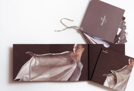 Brochure with three shutters and a compartment in order to hold new collection cards and the invitation card of the event.