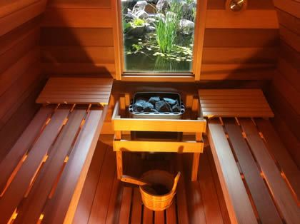 Inside Ukko barrel sauna with window at the back for scenic views